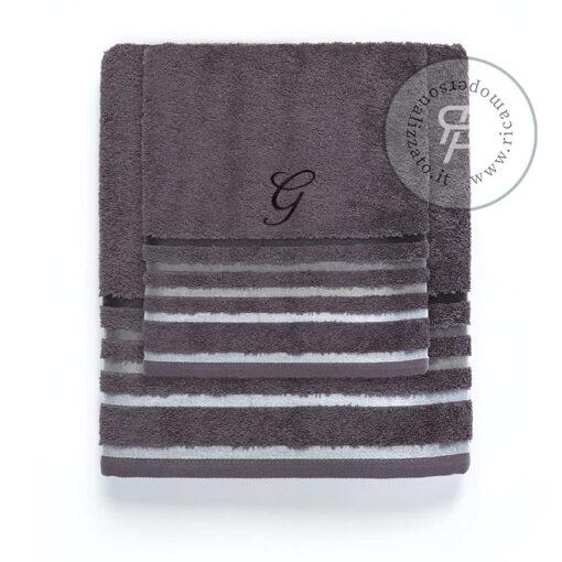 Asciugamani con monogramma centrale su strisce